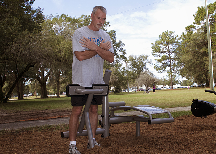 Man exercising on a Back Extension machine at an Outdoor Fitness Park