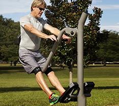 Man exercising on a Leg Press machine