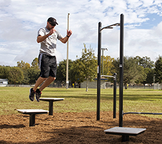 Man Exercising on Plyometric Boxes at an Outdoor Fitness Park