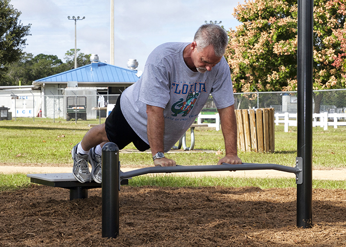 Man doing Push Ups at an Outdoor Fitness Park
