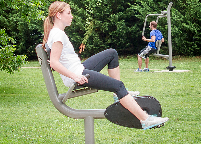 Woman working out on a Recumbent Bike