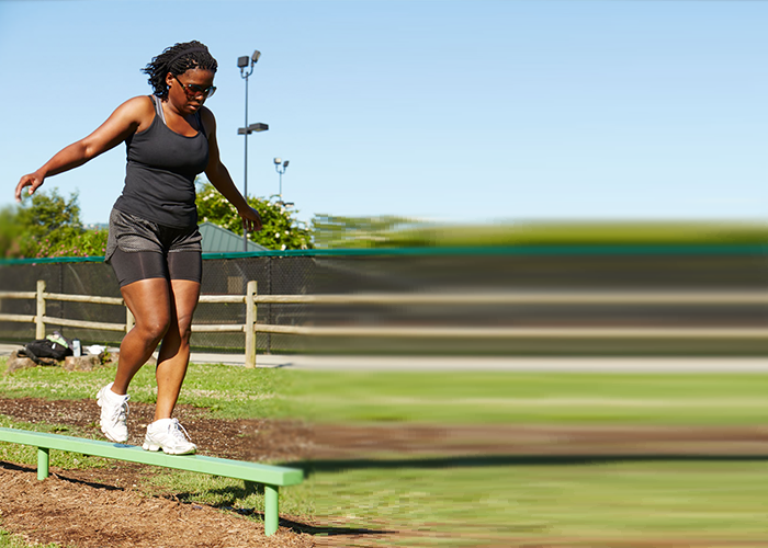 Woman Working out on a Balance Beam