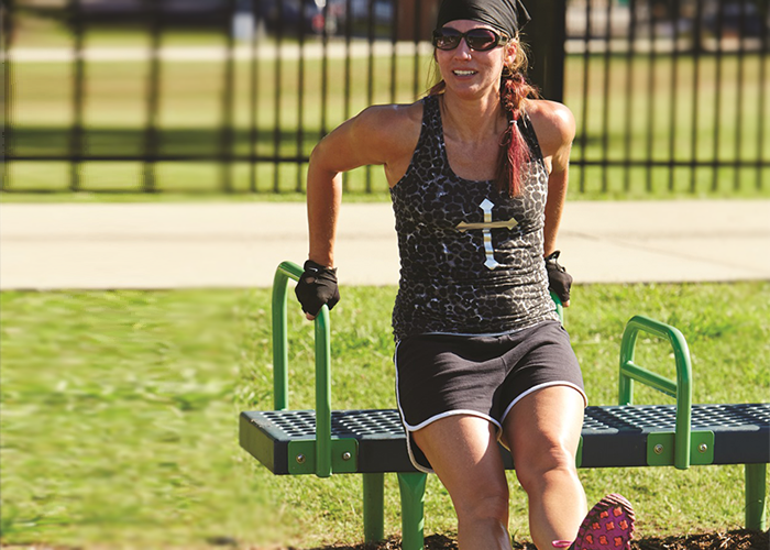 Woman working out on a Bench Dip Machine