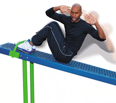Man Exercising on a Body Curl Station