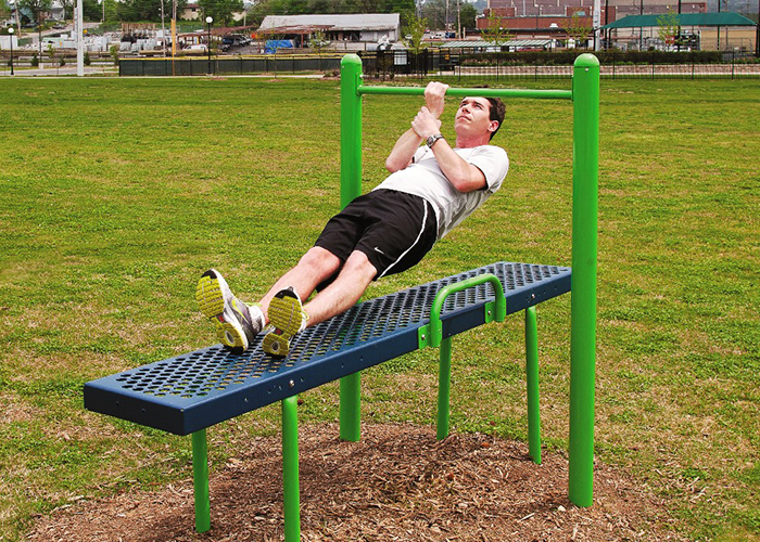 A Man working out on a Chip-Up Machine