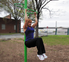 Woman Exercising on a Knee Lift at an Outdoor Fitness Park