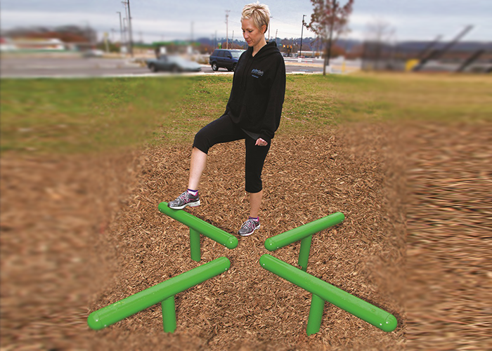 Woman working out on a Log Hop at an Outdoor Fitness Park