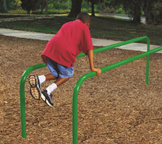 Young child exercising on a Parallel Bar Station