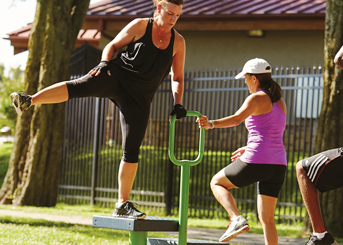 Man and Woman working out on a Step Up Station