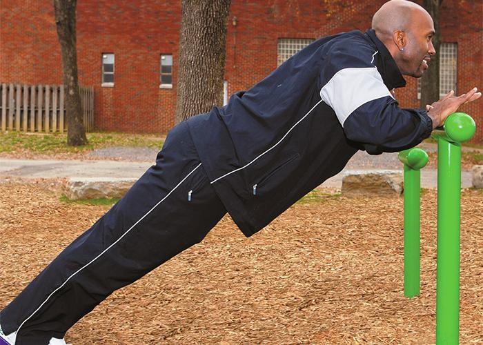 Man Exercising on T Bar Fitness Park Equipment